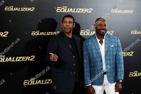 US actor/cast member Denzel Washington (L) poses with US film director Antoine Fuqua (R) during the presentation of their movie 'The Equalizer 2' in Madrid, Spain, 07 August 2018.