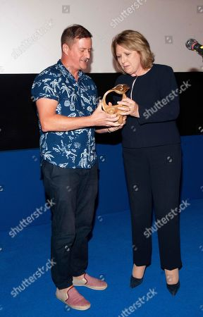 Filmmaker John Butler presents Dr. Mary McAleese, Former President of Ireland, with the inaugural Vanguard Award
