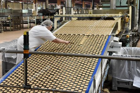 A picture shows the production line of the petit beurre biscuit in the factory of French biscuit manufacturer LU in La Haye-Fouassiere near Nantes