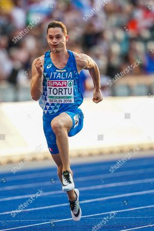 Filippo Tortu of Italy and Chijindu Ujah of Great Britain during 100 meter mens semifinals at the Olympic Stadium in Berlin at the European Athletics Championship