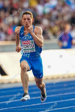 Stock Photo of Filippo Tortu of Italy and Chijindu Ujah of Great Britain during 100 meter mens semifinals at the Olympic Stadium in Berlin at the European Athletics Championship
