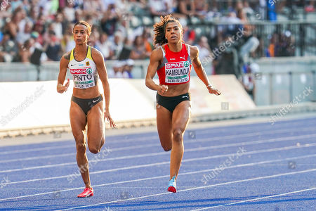 Mujinga Kambundji of Switzerland and Tatjana Pinto of Germany during 100 meter womens semifinals at the Olympic Stadium in Berlin at the European Athletics Championship