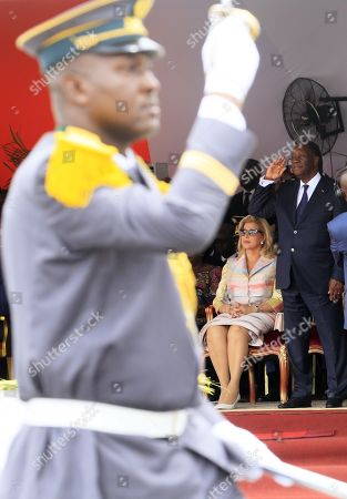 Ivory Coast President Alassane Ouattara (R) with his wife Dominique Folloroux-Ouattara (L) look on a military parade during celebrations marking the 58th anniversary of Independence in Abidjan, Ivory Coast, 07 August 2018. Ivory Coast became independent from the French colonial rule on 07 August 1960.