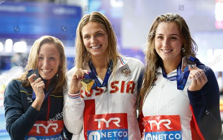Silver medalist Jessica Ball Montero of Spain, left, gold medalist Yuliya Efimova of Russia, and bronze medalist Molly Renshaw of Great Britain pose on the podium of the 200 meters backstroke women final at the European Swimming Championships in Glasgow, Scotland