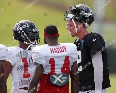 Matt Ryan Marvin Hall, Justin Hardy. Atlanta Falcons quarterback Matt Ryan, right, talks with wide receivers Marvin Hall (17) and Justin Hardy (14) during NFL football training camp, in Flowery Branch, Ga