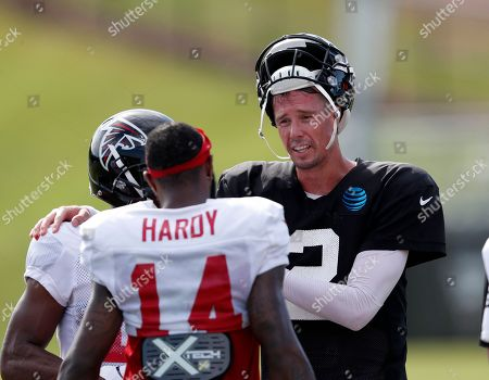 Atlanta Falcons quarterback Matt Ryan (2) talks with Atlanta Falcons wide receiver Justin Hardy (14) during their NFL training camp football practice in Flowery Branch, Ga