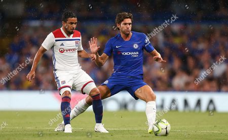 Rafael Da Silva of Lyon and  Marcos Alonso of Chelsea