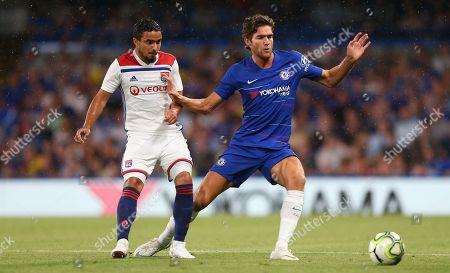 Rafael Da Silva of Lyon battles with  Marcos Alonso of Chelsea