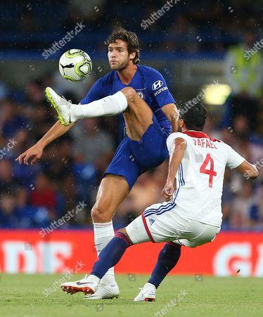 Marcos Alonso of Chelsea and  Rafael Da Silva of Lyon