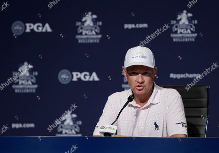 Davis Love III responds to a question during a news conference for the PGA Championship golf tournament at Bellerive Country Club, in St. Louis