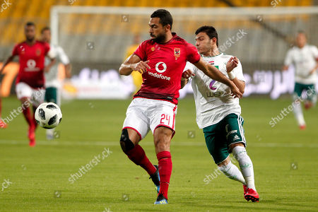 Al Ahly player Ahmed Fathi  (L) in action against Al Masry player (R) Eslam Essa during the Egyptian league soccer match between Al Ahly and Al Masry in Alexandria at Borg Al Arab stadium, Egypt, 07 August 2018.
