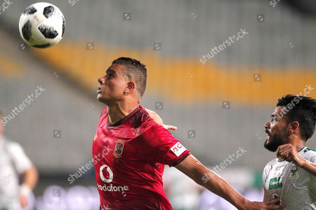 Stock Image of Al Ahly player Saad Samir (L) in action against Al Masry player (R) Hagag Owes during the Egyptian league soccer match between Al Ahly and Al Masry in Alexandria at Borg Al Arab stadium, Egypt, 07 August 2018.