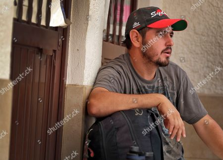 """Jose Blanco, of Honduras, sits with his belongings at the Asociacion Casa Del Migrante """"La Divina Providencia"""" group house in San Luis, Sonora, Mexico. Zavala, stated that he was retiring to Honduras after finding it to difficult to cross into the United States. Thousands of families and unaccompanied children are continuing to cross the U.S. border in Arizona and California even after learning of the government's family separation policy upon apprehension"""