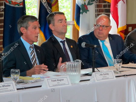 Delaware Gov. John Carney, left, speaks at a meeting of the Chesapeake Executive Council on . Virginia Gov. Ralph Northam is center and Maryland Gov. Larry Hogan is on the right