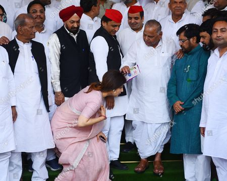 Patriarch of Samajwadi Party Mulayam Singh Yadav with son Akhilesh Yadav and other party leaders as daughter-in-law Dimple Yadav touches his feet during Monsoon Session at the Parliament