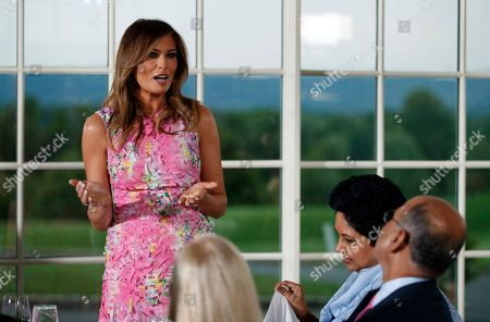Melania Trump, Indra Nooyi. First lady Melania Trump speaks during a dinner meeting with President Donald Trump and business leaders, at Trump National Golf Club in Bedminster, N.J. PepsiCo's departing CEO Indra Nooyi, is second from right