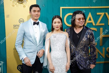 British-Malaysian actor/cast member Henry Golding (L-R) US actress/cast member Constance Wu and US book author/executive producer Kevin Kwan attend the US premiere of 'Crazy Rich Asians' at the TCL Chinese Theatre IMAX in Hollywood, Los Angeles, California, USA, 07 August 2018. The movie opens in the US on 15 August.