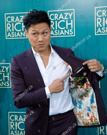 US director Jon M. Chu points to his name embroidered in his jacket while attending the US premiere of 'Crazy Rich Asians' at the TCL Chinese Theatre IMAX in Hollywood, Los Angeles, California, USA, 07 August 2018. Chu's movie opens in the US on 15 August.