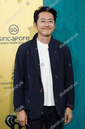 Stock Photo of US actor Steven Yuen attends the US premiere of 'Crazy Rich Asians' at the TCL Chinese Theatre IMAX in Hollywood, Los Angeles, California, USA, 07 August 2018. The movie adaptation of Kwan's book opens in the US on 15 August.