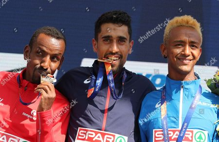 (L-R) Belgium's Bashir Abdi, France's Morhad Amdouni and Italy's Yemaneberhan Crippa celebrate as they receive their medals during the medal ceremony for the men's 10,000m of the Athletics 2018 European Championships in Berlin, Germany, 08 August 2018.