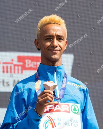 Italy's Yemaneberhan Crippa celebrates as he receives his bronze medal during the medal ceremony for the men's 10,000m of the Athletics 2018 European Championships in Berlin, Germany, 08 August 2018.