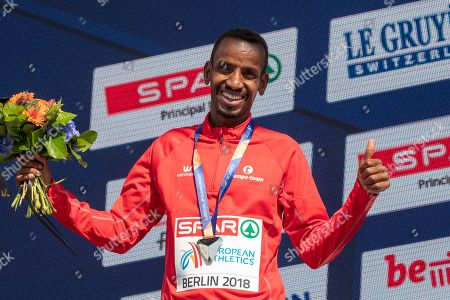 Belgium's Bashir Abdi celebrates as he receives his silver medal during the medal ceremony for the men's 10,000m of the Athletics 2018 European Championships in Berlin, Germany, 08 August 2018.
