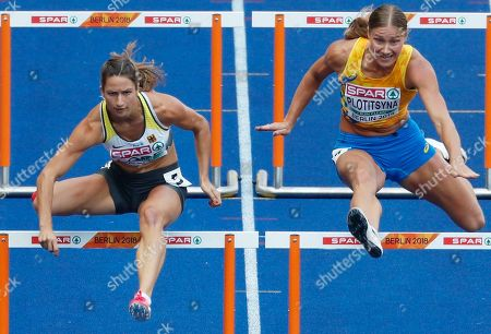 Ricarda Lobe (L) of Germany competes in the women's 100m Hurdles Heats  at the Athletics 2018 European Championships in Berlin, Germany, 08 August 2018.