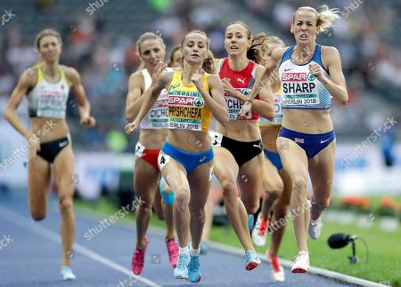 Ukraine's Nataliya Pryshchepa, front left, and Britain's Lynsey Sharp, front right, compete during a women's 800 meter semi final race at the European Athletics Championships in Berlin, Germany