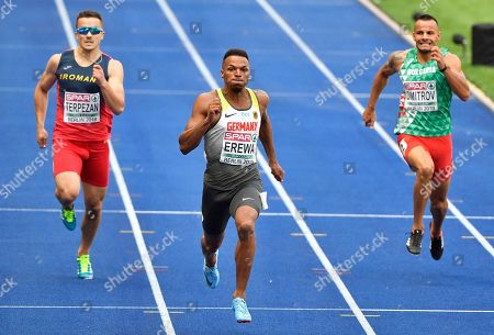 Romania's Alexandru Terpezan, Germany's Robin Erewa and Bulgaria's Denis Dimitrov, from left, compete in a men's 200-meter heat at the European Athletics Championships in Berlin, Germany