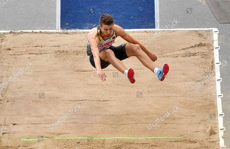 Germany's Fabian Heinle makes an attempt in the men's long jump final at the European Athletics Championships in Berlin, Germany