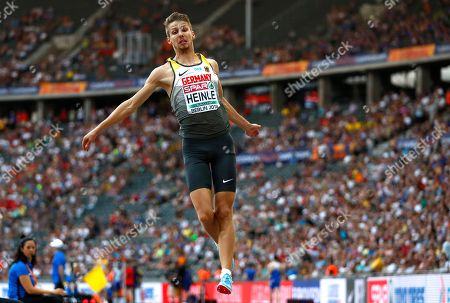 Germany's Fabian Heinle makes an attempt in the men's long jump final at the European Athletics Championships at the Olympic stadium in Berlin, Germany