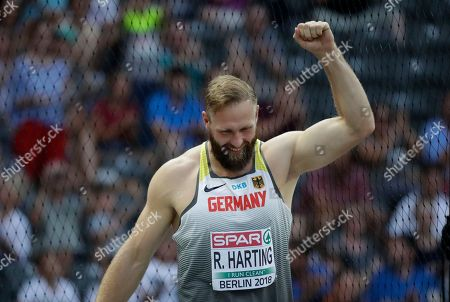 Germany's Robert Harting reacts when is welcomed by standing ovations prior to the men's discus throw final at the European Athletics Championships at the Olympic stadium in Berlin, Germany
