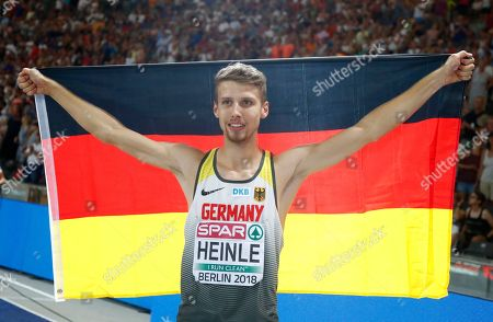 Germany's Fabian Heinle celebrates after winning the silver medal in the men's long jump final at the European Athletics Championships at the Olympic stadium in Berlin, Germany