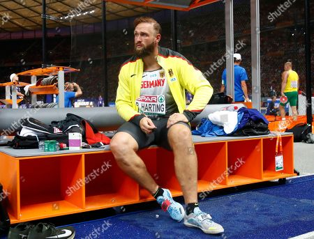 Germany's Robert Harting watches the mens' discus final at the European Athletics Championships at the Olympic stadium in Berlin, Germany