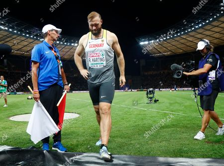 Germany's Robert Harting leaves the field after the men's discus throw final at the European Athletics Championships at the Olympic stadium in Berlin, Germany