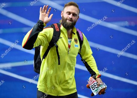 Germany's Robert Harting leaves the stadium after the men's discus throw final at the European Athletics Championships in Berlin, Germany