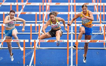 Finland's Reetta Hurske, Germany's Ricarda Lobe and Ukraine's Hanna Plotitsyna, from left, compete in a women's 100-meter hurdles heat at the European Athletics Championships in Berlin, Germany