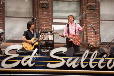 Rusty Anderson and Sir Paul McCartney on the roof with his band