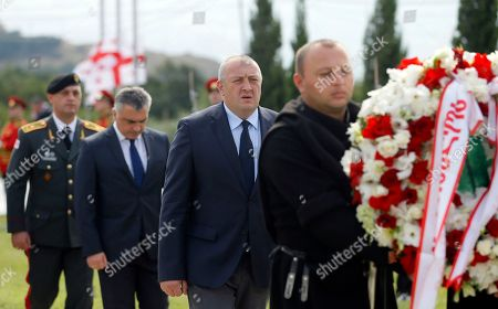 Georgian President Giorgi Margvelashvili (C) attends a wreath laying ceremony at a cemetery in Tbilisi, Georgia, 08 August 2018. An official ceremony was held here on the occasion of the tenth anniversary of the Russian-South Ossetian-Georgian conflict, or Russo-Georgian War, in August 2008.