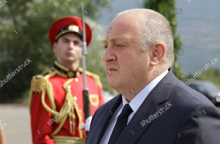 Georgian President Giorgi Margvelashvili attends a wreath laying ceremony at a cemetery of victims of the August 2008 war conflict between Russia and Georgia in Tbilisi, Georgia, . Commemorating events were held in Georgia to mark the 10 year anniversary of the August 2008 Russia-Georgia war