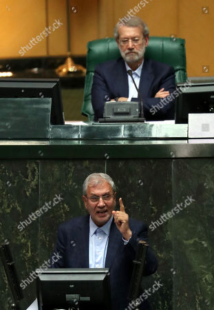 Iranian Labor Minister Ali Rabiei speaks to defend himself as Iranian Parliament Speaker Ali Larijani (top) listens during an impeachment session at the Iranian Parliament in Tehran, Iran, 08 August 2018. Media reported that parliament sacked Rabiei as Minister of Labor. As Iran is facing economic crises the parliament impeached Labor Minister Ali Rabiei and voted to sack him.