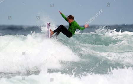 Lukas Skinner age 10 son of the famous surfer Ben Skinner taking part in Mens Quiksilver Open, World Surf League Men's Qualifying Series QS #40 1,000 at  Boardmasters held at Fistral Beach, Newquay, Cornwall. Lukas is the youngest ever competitor in Boardmasters