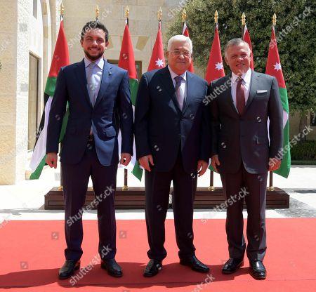 Visiting Palestinian President Mahmoud Abbas, Jordanian King Abdullah II and Jordanian Crown Prince Hussein bin Abdullah pose for a photo in Amman