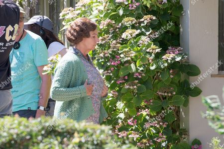 Stock Image of actor Tessa Peake-Jones filming the ITV drama Grantchester in the village of Grantchester near Cambridge.It was her first scenes with actor Tom Brittney who has replaced James Norton. New vicar of ITVs Grantchester Tom Brittney looks a world apart from James Norton's character - as he filmed scenes dressed as a leather-clad biker. The 27-year-old Outlander and Call The Midwife star was seen riding a motorbike as he filmed scenes for the new series of the 1950's crime-drama in Grantchester.