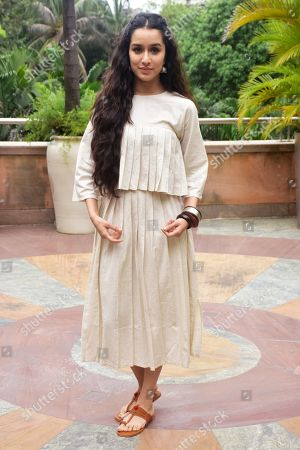 """Indian film actress Shraddha Kapoor poses during the promotion of her upcoming film """"Stree"""" at hotel Novotel Juhu in Mumbai."""