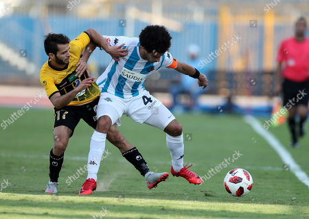 Al-Entag al-Harby player Abdel Rahman Boudy (L) in action against Pyramids FC player Omar Gaber (R) during the Egyptian Premier League soccer match between Al-Entag al-Harby and Pyramids FC, in Cairo, Egypt, 08 Aygust 2018.