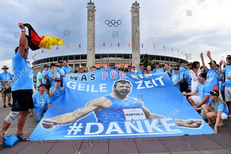 Supporters of Germany's Discus Throw Robert Harting at the 2018 European Athletics Championships in the front of the Olympic stadium in Berlin, Germany, Wednesday, August 08, 2018.