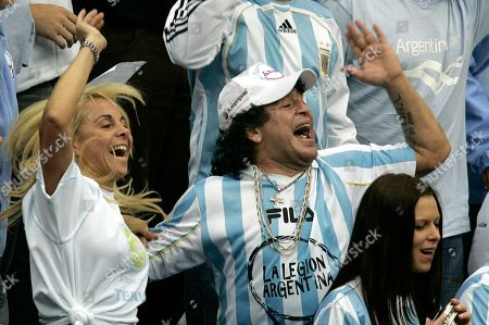 Argentina's former soccer great Diego Maradona and his ex-wife Claudia Villafane, left, support their national team during the Davis Cup Final tennis match against Russia, in Moscow. An appeals court has ruled, that Maradona can pursue a lawsuit against his ex-wife claiming she misappropriated some of his money to buy Florida real estate