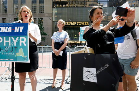 Stock Picture of Candidate for New York attorney general Zephyr Teachout (L) is endorsed by Democratic candidate for New York governor Cynthia Nixon (C) as woman (R) takes a selfie during a press conference across the street from Trump Tower in New York, New York, USA, 08 August 2018. Teachout is running against a crowded field of candidates for the New York Attorney General position that was vacated when the former Attorney General Eric Schneiderman resigned.