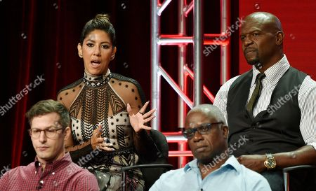 """Stephanie Beatriz, Terry Crews, Andy Samberg, Andre Braugher. Stephanie Beatriz, top left, a cast member in the NBC Universal television series """"Brooklyn Nine-Nine,"""" answers a question as fellow cast members, from left, Andy Samberg, Andre Braugher and Terry Crews look on during the 2018 Television Critics Association Summer Press Tour, in Beverly Hills, Calif"""